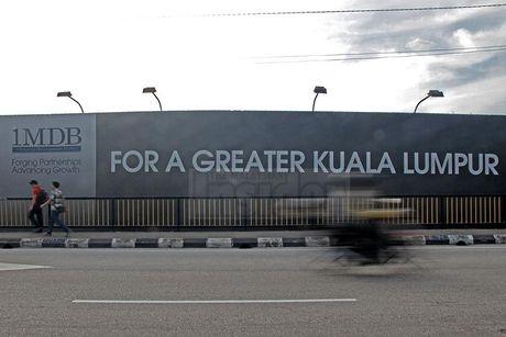 Malaysia phat tu nghi sy doi lap vi de lo chi tiet ve quy 1MDB - Anh 1