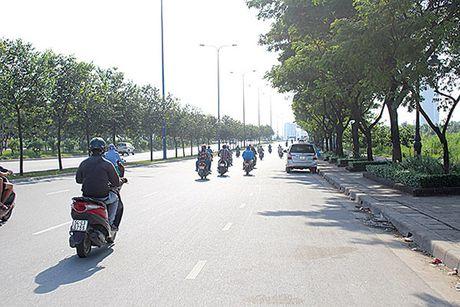 TP.HCM: Sau chan chinh, xe du vang bong - Anh 1