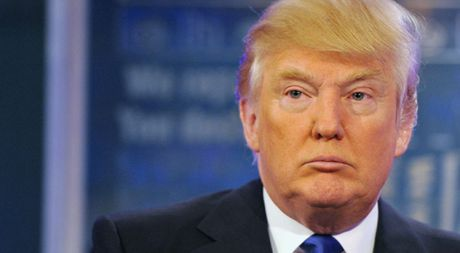 Ong Donald Trump doi mat voi noi lo lam phat - Anh 1