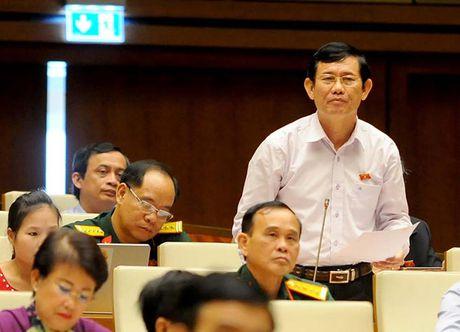 Toan canh Bo truong Cong Thuong Tran Tuan Anh tra loi chat van - Anh 9