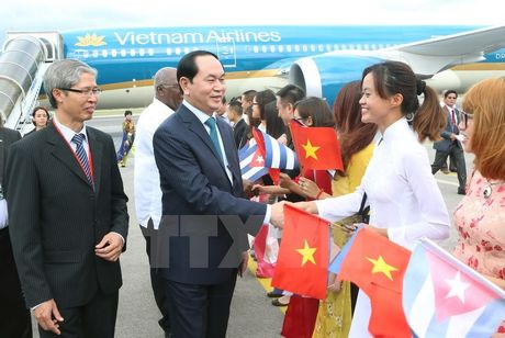 Chu tich nuoc va Phu nhan bat dau chuyen tham chinh thuc Cuba - Anh 1