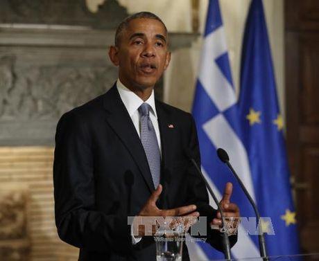 "Tong thong Obama hoi thuc ""dieu chinh dung quy dao"" toan cau hoa - Anh 1"