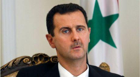 Tong thong Assad nghi ngo chu kien cua ong Donald Trump - Anh 1