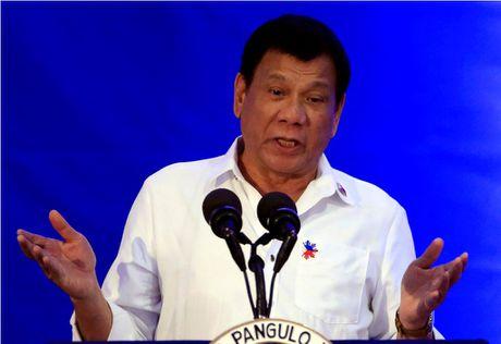 Tong thong Philippines tuyen bo se theo Nga, rut khoi Toa hinh su quoc te - Anh 1