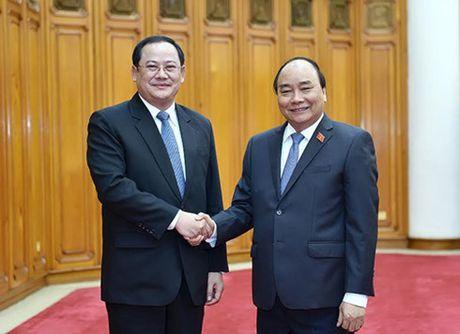 Thu tuong Nguyen Xuan Phuc tiep Pho Thu tuong Lao Sonsay Siphandone - Anh 1