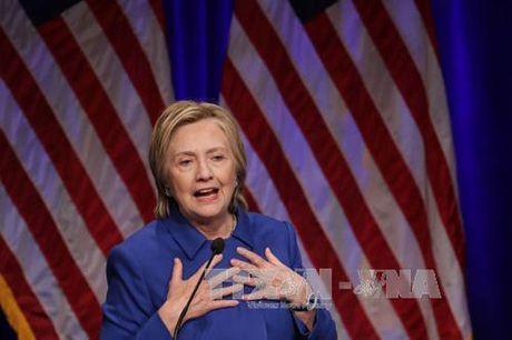 Ba Clinton vuot xa ong Trump phieu pho thong - Anh 1