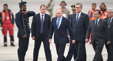 Tong thong Putin: Donald Trump san sang binh thuong hoa quan he voi Nga - Anh 1