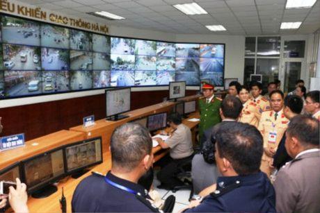 CSGT ASEAN tham trung tam dieu khien giao thong Ha Noi - Anh 1