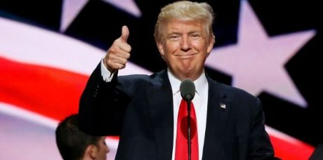 Trump duoc nguoi My tin tuong hon ca 4 doi tong thong truoc - Anh 1