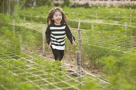 Xuan Lan va con gai vui dua trong nang am dau dong Ha Noi - Anh 11