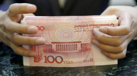 Ong Trump doa tang thue, Trung Quoc 'lay' WTO ra de - Anh 1