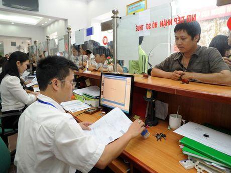 Ha Noi: Hon 96% doanh nghiep da ke khai thue qua mang - Anh 1