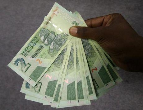 "Chan tien ti do, Zimbabwe phat hanh ""phien ban USD"" - Anh 1"