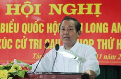 Pho Thu tuong Truong Hoa Binh tiep xuc cu tri tai Long An - Anh 1