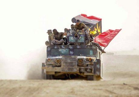 Dan chung Iraq dua nhau tro ve nha sau giai phong - Anh 1