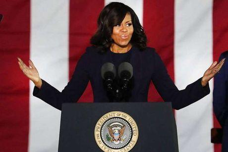 Ong Obama: Vo toi se khong bao gio tranh cu tong thong - Anh 1