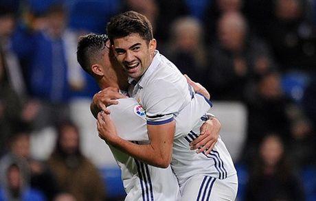 Barcelona gay that vong, con trai Zidane gop cong trong tran dai thang cua Real - Anh 4