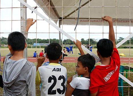DTVN: Huu Thang lam 100 phong vien o Indonesia bat ngo - Anh 7
