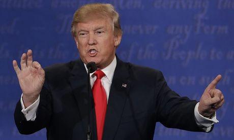 Trump tuyen bo gac viec kinh doanh de tranh 'xung dot loi ich' - Anh 1