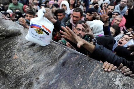 Cuoc song ben trong khu vuc do quan chinh phu kiem soat o Aleppo - Anh 1