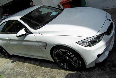 Hotgirl 'tho dan nguc tran' tau BMW M4 mui tran 4,2 ty - Anh 11