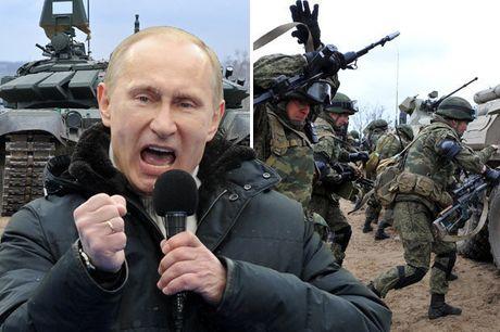Ukraine ban ten lua, ong Putin huy dong 55.000 binh si den bien gioi - Anh 1