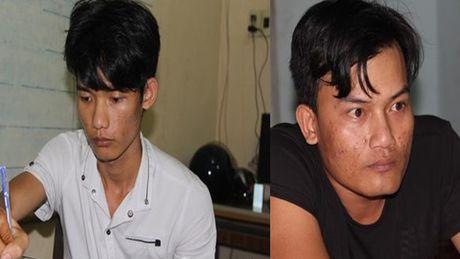 Bat hai doi tuong dung sung cuop tiem vang Kim Phung - Anh 1