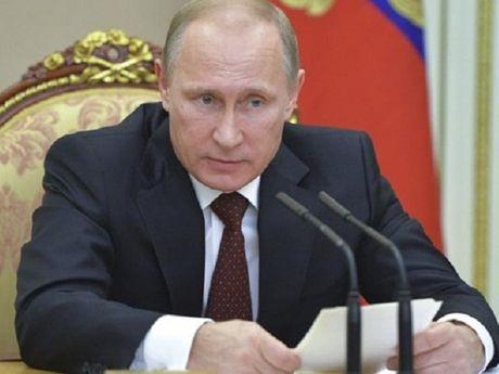 Ong Putin: Nam 2016, FSB ngan chan 45 vu tan cong co tinh chat khung bo - Anh 1
