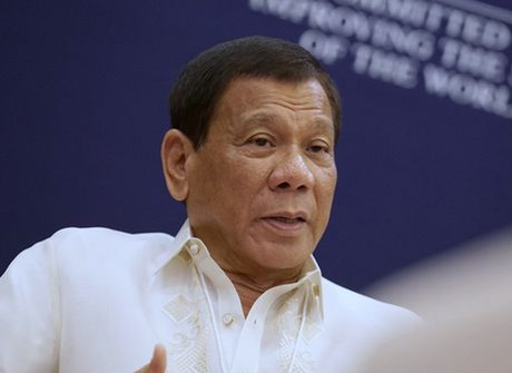 Ong Duterte: Chu tich Trung Quoc canh bao cung ran nhung than thien - Anh 1