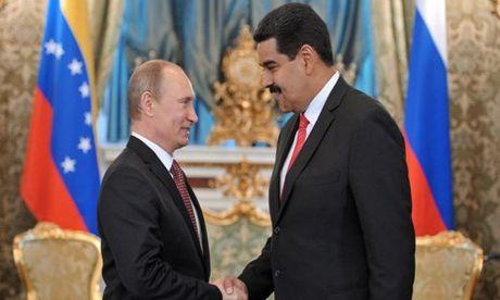 Ong Putin hua vien tro luong thuc cho Venezuela - Anh 1