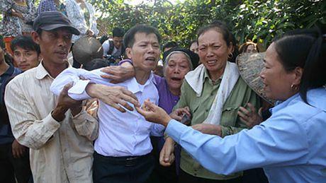 Nha nuoc chu dong phuc hoi danh du cho nguoi bi oan - Anh 1