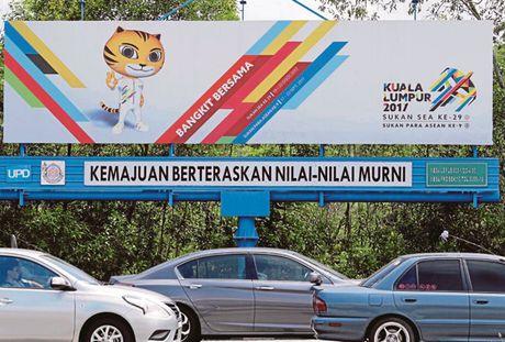 Bao Malaysia noi chu nha se thau tom HCV o SEA Games 29 - Anh 1