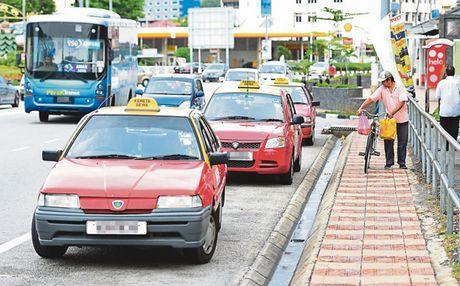 Kinh nghiem Malaysia giai quyet mau thuan taxi voi Uber/Grab - Anh 1