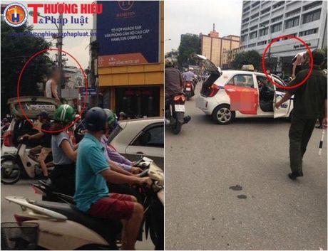 Bi CSGT dung xe, tai xe taxi dua giay xac nhan phoi nhiem HIV - Anh 1
