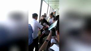 Nữ hành khách gào thét đòi nhảy xuống biển vì rơi smartphone