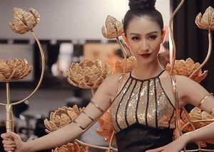 Hà Thu mặc trang phục dân tộc 15 kg thi Miss Earth