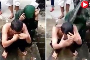 Dân làng thi nhau dội nước cống lên đầu cặp đôi ngoại tình