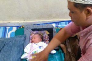 Bé gái chào đời trong ngày khai mạc ASIAD 18 được đặt tên 'Asian Games'