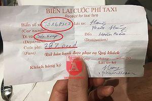 Lập biên bản tạm giữ xe taxi dù thu sai cước của vị khách Nhật Bản