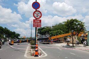 Cần cẩu ngã chắn ngang đại lộ ở Sài Gòn